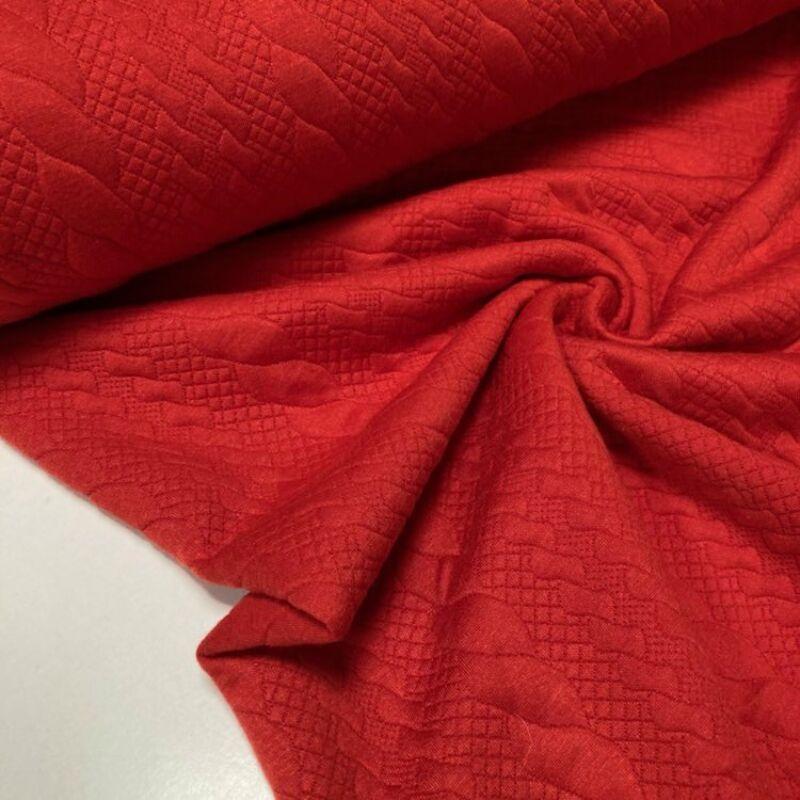 piros csavart mintás kötött hatású anyag